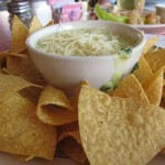 Artichoke spinach dip with tortilla chips